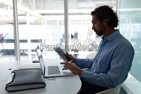 businessman working on digital tablet and