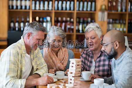 happy friends playing jenga game while