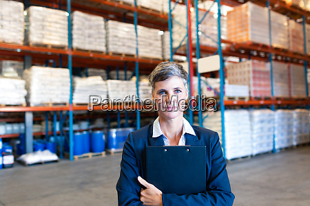 female manager holding clipboard and looking