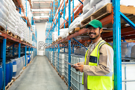 male worker holding digital tablet and