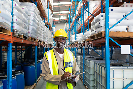 male worker looking at camera while