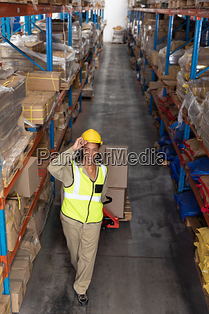 female worker carrying cardboard boxes on