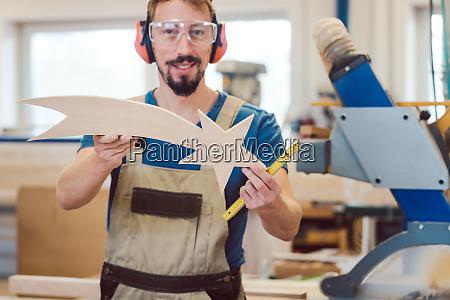 carpenter doing woodworks for christmas