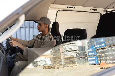 delivery man with cardboard boxes sitting