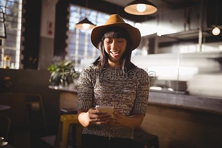 smiling beautiful female customer using mobile