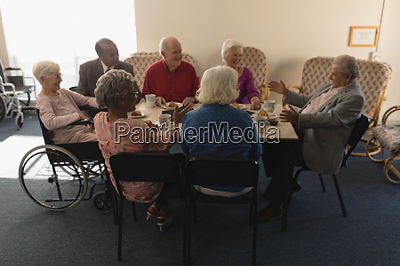 group of senior friends having breakfast