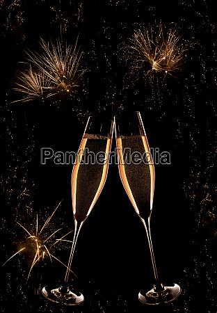 champagner und goldenes feuerwerk