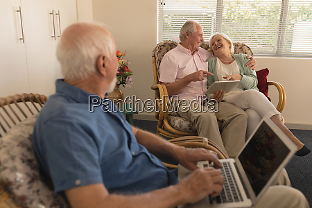 senior man using laptop while senor