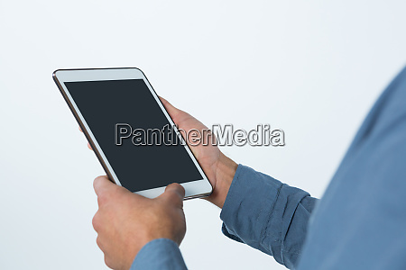 businessman using digital tablet against white