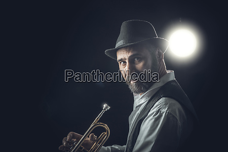 jazz trumpet player on a dark