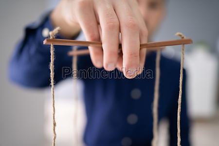 manipulieren marionette saiten firmen hand marionette