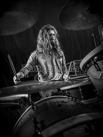 young man playing the drums on