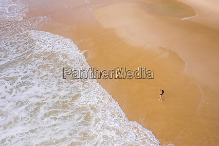 aerial view of woman photographing at