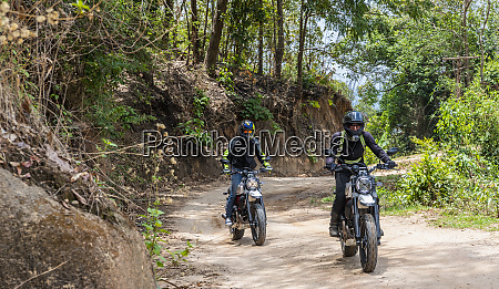 bikers riding off road motorcycle on