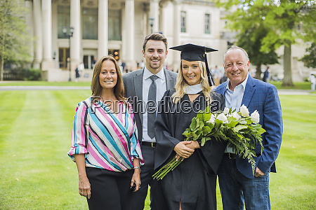 proud family with graduating student at