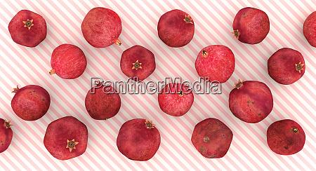 granataepfel auf rosa und weiss diagonal