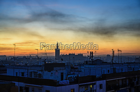 cityscape with seville cathedral at sunrise