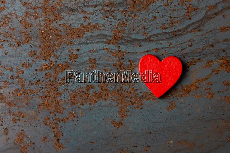 red wooden heart on a metal
