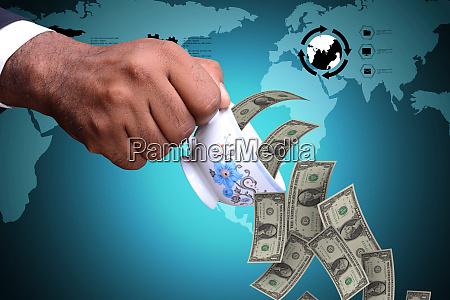 mann hand mit teetasse und geldscheine