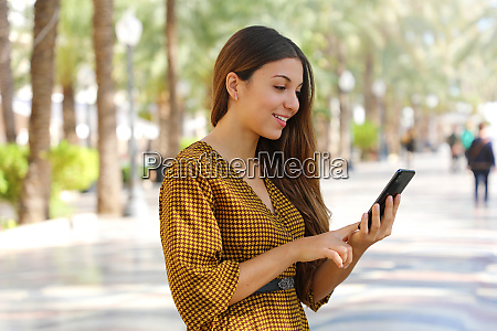 happy cheerful young woman typing with