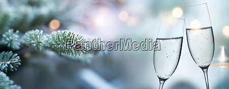 fir branches in winter and champagne