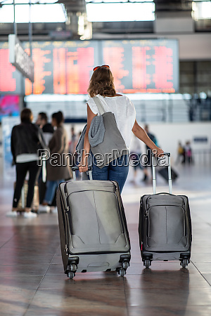 young woman with her luggage at