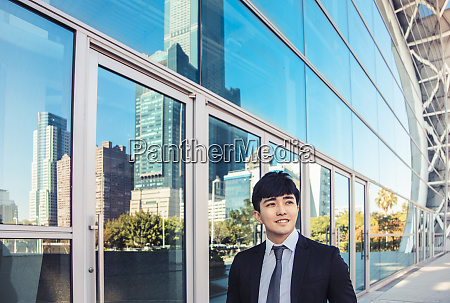 smiling business man standing in front