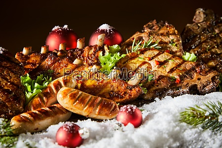 assortment of grilled meats on winter