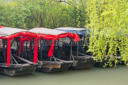boats with willow trees on the