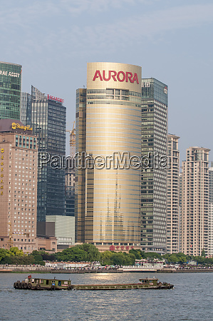 pudong district skyline with shipping on