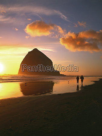 usa oregon cannon beach couple walking