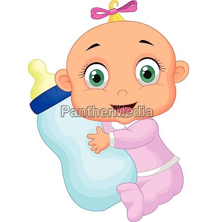 baby girl holding milk bottle