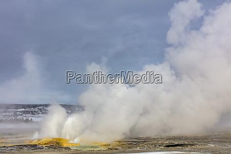 clepsydra geyser in winter in yellowstone