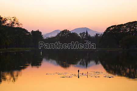 sunset, over, a, lake, in, thailand's - 27721602