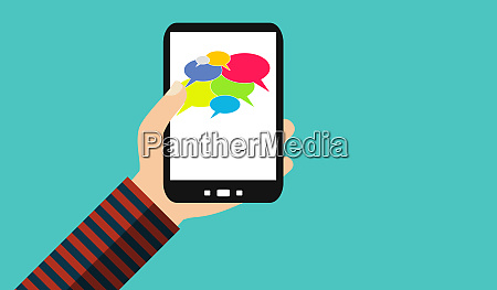 hand mit handy social media sprechblasen