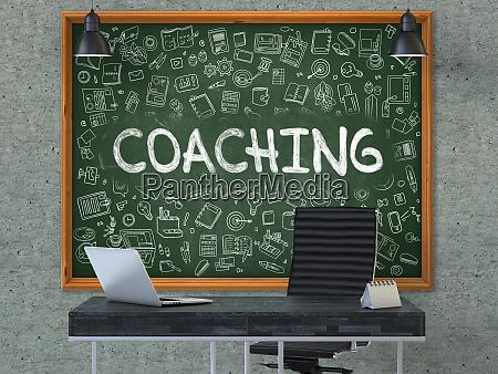 coaching hand gezeichnet auf gruene