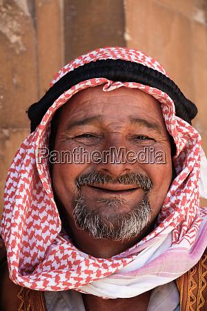 egyptian man wearing traditional headdress called