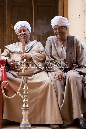 men smoking water pipes or shisha
