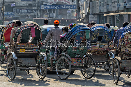 rickshaws on the street dhaka bangladesh
