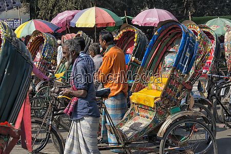 colorful rickshaws on the street dhaka