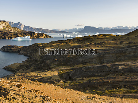 landscape with icebergs in the uummannaq