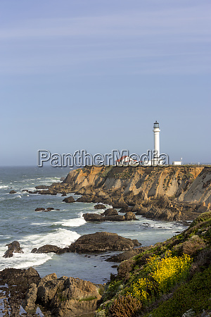 point arena lighthouse on cliffs over