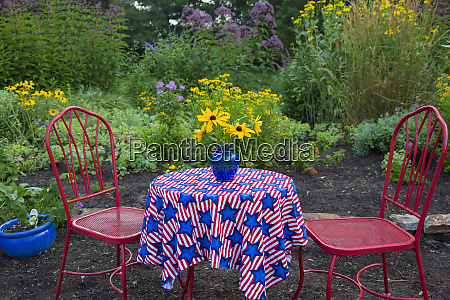 flower garden with red table and