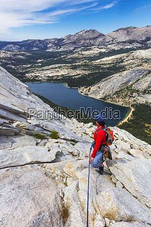 rock climber on tenaya peak tuolumne