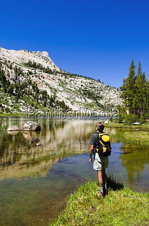 hiker at elizabeth lake under unicorn