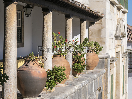 portugal obidos ceramic pots adorning a