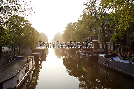 canal sunrise amsterdam the netherlands north