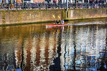 kayak rowing reflection singel canal amsterdam