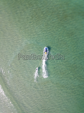 aerial view of a surfer being