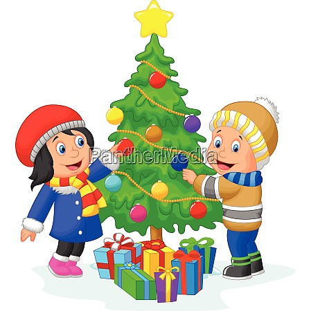happy kids decorating a christmas tree
